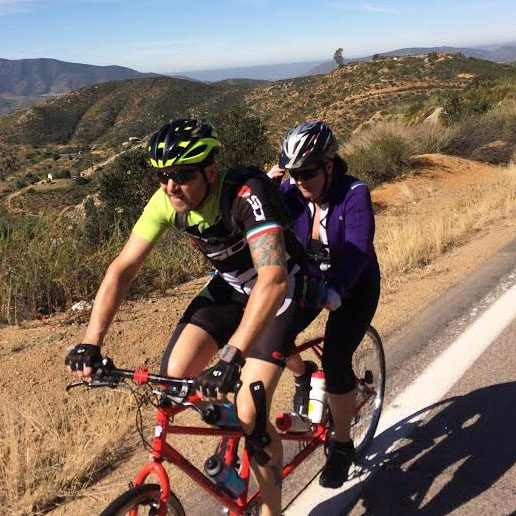 Maria Johnson and a friend riding a tandem bicycle